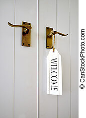 Welcome sign on a door. concepts and ideas