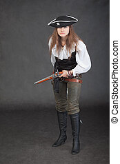 Woman in a costume of sea pirate on black background