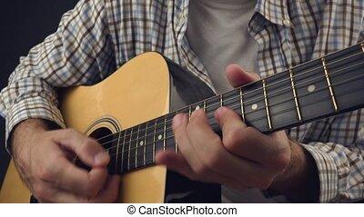 Man playing rock tune on guitar - Man playing rock tune on...
