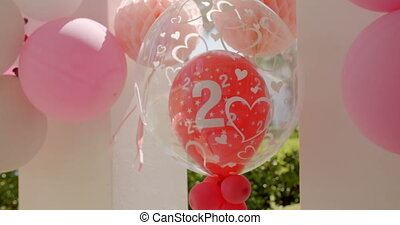 Helium balloons celebrating a two year anniversary -...