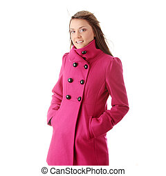 Teen woman in pink female coat isolated on white background