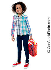 It's hard to carry my bag. - Image of a happy girl with...