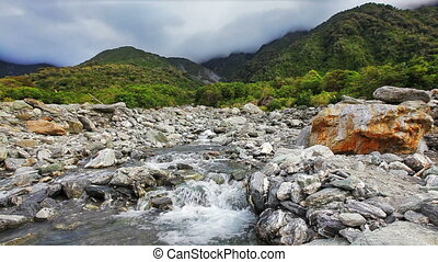 Rapid creek running from mountains. South island, New...