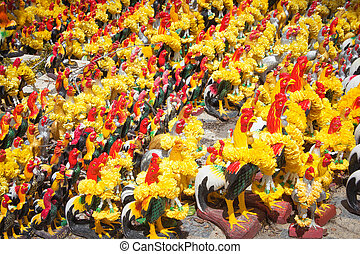 Chicken crowd statue for pay off a bet