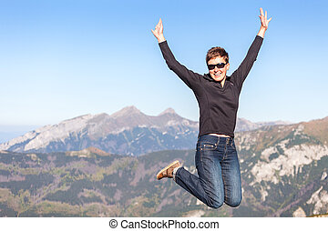 Happy jumping tourist in the mountains - Happy jumping...