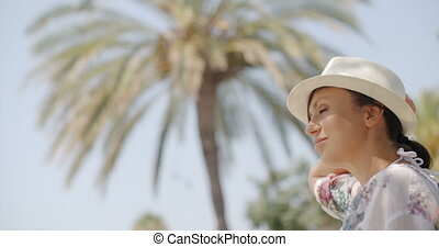 Woman Looking into the Distance on Palm Beach - Close Up of...