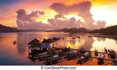 Sunset over Coron harbour timelapse, Coron, Palawan,...