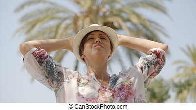 Relaxed Woman with Eyes Closed on Palm Tree Beach - Close Up...