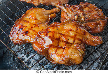 Chicken grilled on charcoal.