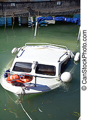 sunken yacht in italy under water boat close detail