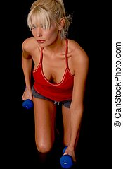 Fitness Girl - Lovely blond girl working out with weights