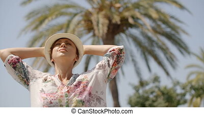 Woman with Open Arms on Beach with Palm Trees - Close Up of...