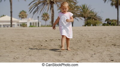 Cute Little Girl Walking on the Beach on Slow Motion Video