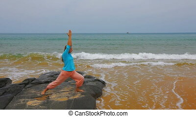 Yoga exercises by the ocean