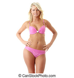 Beautiful model in pink bikini posing on a white background...