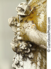 wreath of flowers in hand - antique sculpture detail