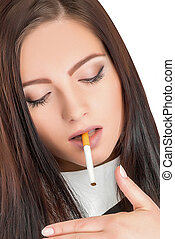 woman smoking cigarette - portrait of a beautiful lady in...