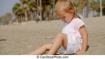 Cute Young Girl Playing on Sandy Tropical Beach on Slow...