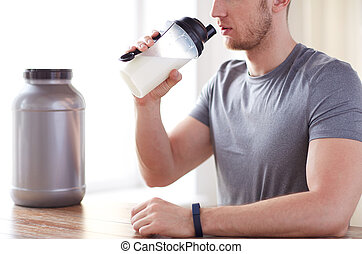 close up of man drinking protein shake - sport, fitness,...