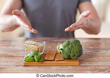 close up of male hands showing food rich in fiber - healthy...