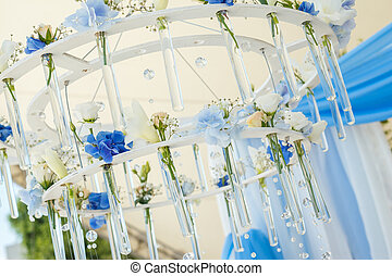 chandelier of flowers for wedding arch