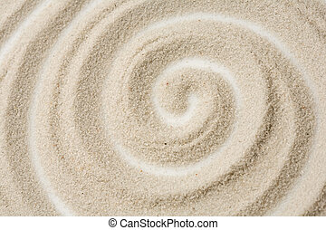 Photo of spiral pattern in the sand