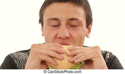Young Man Eating Sandwich studio shot