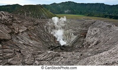Panoramic view from the Bromo crater. Crater in the...