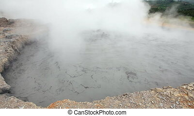 boiling mud in the volcano crater - boiling mud in the...