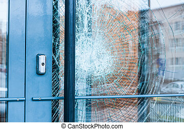 Broken glass front door outside