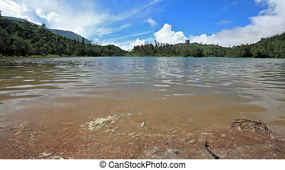 release of volcanic gases from the Telaga Warna lake located...