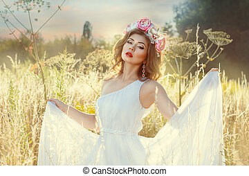 The beautiful gentle girl in white dress She stands in a...