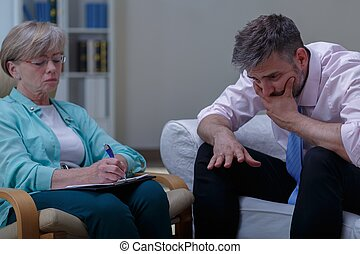 Therapist analysing problem of patient