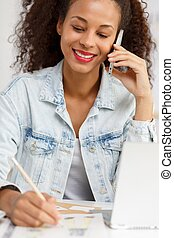 Self-employed woman talking - Picture of smiling...