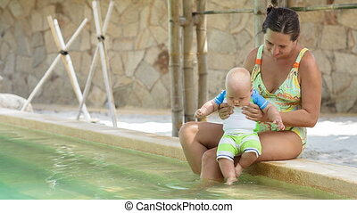 Mother and baby at swimming pool