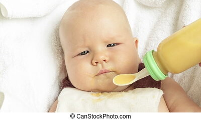 Baby Feeding With Spoon Feeder