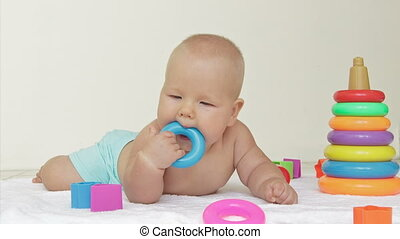 Baby chews toy - Baby chews ring toy on light background