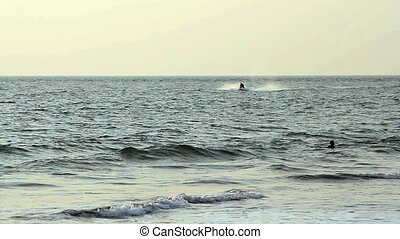 Unidentified Young guy cruising on a jetski. Goa state...
