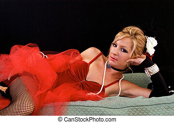 woman laying on sofa - Beautiful blonde laying on chaise...