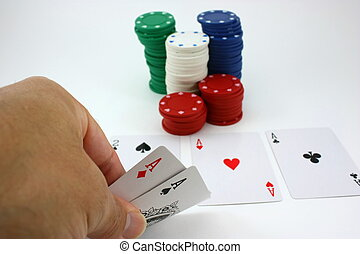Poker player views pocket aces, four of a kind