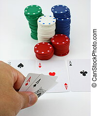 Poker player has pocket aces, four of a kind - Player views...