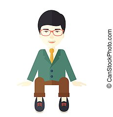 Businessman is sitting - A happy japanese businessman...