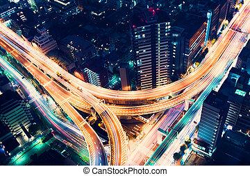 Aerial-view highway junction at night in Tokyo, Japan -...