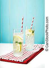 Lemonades with big red striped straws