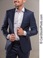Fashion suit - Handsome nifty man in blue suit on gray...