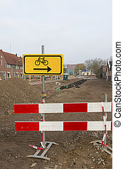 road work with a detour sign for cyclists