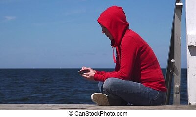 Young woman using mobile phone - Young woman using mobile...