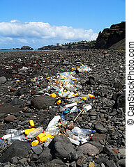 Polluted Beach - A rocky beach is strewn with litter.
