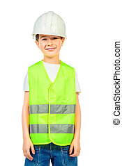 construction - Cute boy in a costume of a builder posing...