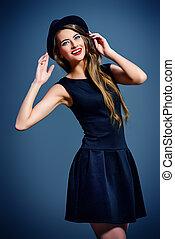high spirits - Joyful pretty girl wearing black dress and...